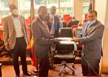 Finance Minister Matia Kasaija and Faruk Awadh, Director for Operations Africa signed on behalf of RippleNami at the signing ceremony (PHOTO/Courtesy)
