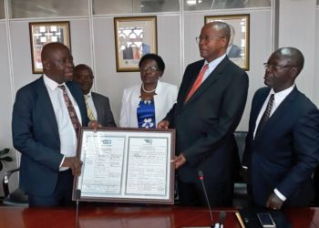 Dr. David Kakuba handing over the Air operator certificate for Uganda Airlines to then Works Minister Monica Azuba (PHOTO/PML Daily)