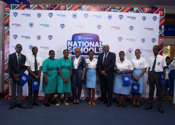 Ms Barbara Kasekende the Head of CSI at Stanbic poses for a photo with Mr Japheth Katto Stanbic Bank Chairman and other students at the launch of the National Schools Championships (PHOTO/Courtesy).