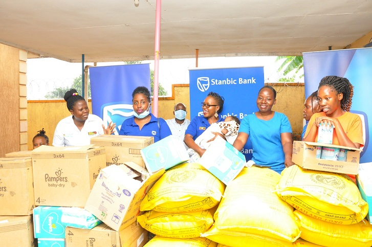 Stanbic Corporate Social Investments Manager Barbara Kasekende carries a baby at Loving Hearts Babies Home in Munyonyo (PHOTO/Courtesy).