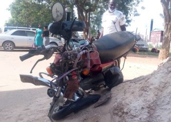 Thwreckage of the motorcycle that was involved in the accident at Mbarara central police station on thursday.PHOTO BY FELIX AINEBYOONA