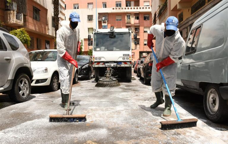 Health workers disinfect a public area in Casablanca, Morocco, on June 7, 2020. (Photo by Chadi/Xinhua)