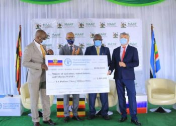 Russian Amb. HE. Alexander Pulyakov (R) hands over a $3M cheque to Hon. Vincent Sempijja (PHOTO/Courtesy).