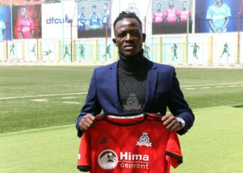 Galiwango poses with a Vipers SC jersey at St. Mary's Kitende on Wednesday. (PHOTOS/Vipers SC)