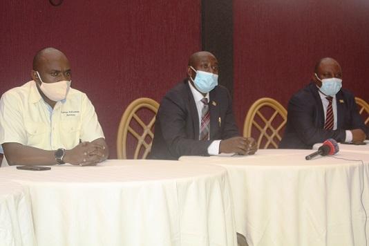 Aston Arianitwe Rwakajara (L), James Tweheyo and Alex Kwatampora at a recent workers meeting in Fort Portal