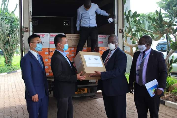 CCCC deputy director hands over PPEs to UCAA officials (PHOTO/Courtesy).