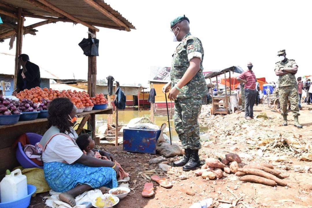 Maj Gen Leopold Eric Kyanda visiting Port Bell market on Thursday (PHOTO/Courtesy).