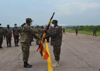 Gen David Muhoozi (L), the Chief of Defense Force flagging off