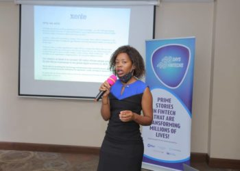 Lyn Tukei presenting about Xente's role in promoting financial inclusion with a focus on BUBU, women & youths led businesses (PHOTO/Courtesy)