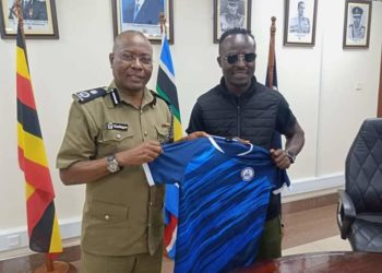 Tonny Mawejje (R) with out-going Police FC CEO Asan Kasingye (L) on Monday. (PHOTO/Courtesy)