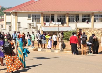 People lineup at Mbarara regional Referral hospital as they enter to seek health services on Wednesday (PHOTO/FELIX AINEBYOONA).
