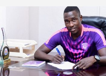 Edward Satulo smiles for the camera while signing for Wakiso on Monday, July 20. (PHOTO/Wakiso Giants FC)
