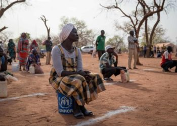 Sudanese refugees observe physical distancing during a food and soap distribution at Ajuong Thok camp in South Sudan, April 2020 (PHOTO/UNHCR)