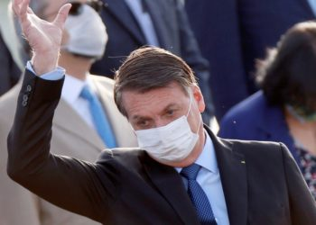 Brazil's President Jair Bolsonaro wearing a protective face mask gestures during a recent national ceremony (PHOTO/Courtesy)