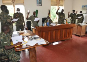 Members of the Division Court Martial being sworn in