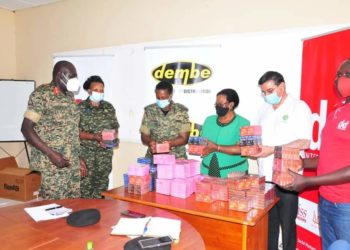 Dembe Distribution Company Officials handing over the donated condoms to the UPDF on Friday (PHOTO/Courtesy).