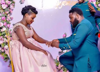 Comedian Chiko putting a ring onto his love's finger (PHOTO/Courtesy).