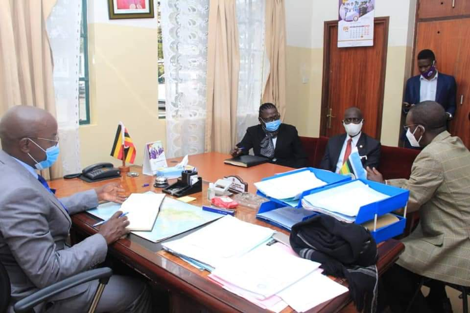 Principal Judge, Dr Flavian Zeija and other judicial Officials during a meeting