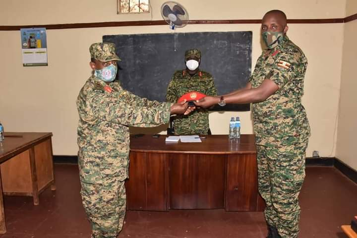 Brigadier William Bainomugisha hands over to Col. Katungi (PHOTO/File)