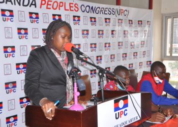 Uganda People's Congress (UPC) Spokesperson Sharon Arach Oyat speaking at a press conference at party headquarters, Uganda House, Kampala