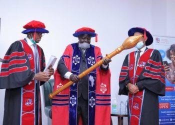 Prof. Asubo receives the button as new Victoria University Chancellor (PHOTO/Courtesy).