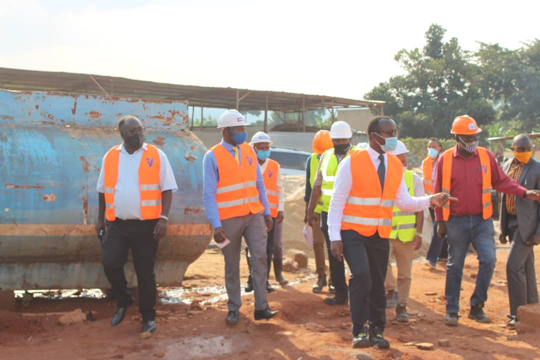 NWSC MD Dr. Eng Silver Mugisha and other engineers inspecting