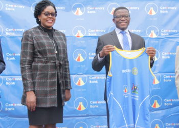 Buganda Katikkiro, Owek. Charles Peter Mayiga (R) displaying a Rotary Cancer Run 2019 kit, joined by Mrs.Beatrice Lugalambi, (L) General Manager Corporate Communications and Marketing. This was at Bulange in Mengo, where the Katikkiro confirmed his participation in the Virtual Rotary Cancer Run to be held on Sunday,  30th  August 2020 (PHOTO/Courtesy)