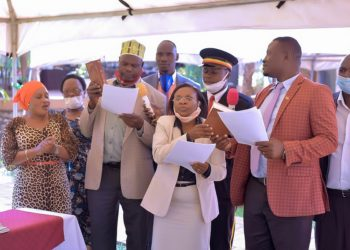 Hon. Maureen Tumusiime taking an oath as as Executive Secretary for Gender, Community Services, Market, Education and Social Services (PHOTO/Nelson Mandela).