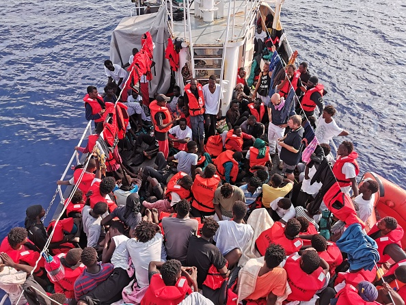 "31 August 2019, ---: About 100 migrants are crowded together on deck of the rescue ship ""Eleonore"". The ""Eleonore"" took in the migrants on 26.08.2019 off the Libyan coast. The people were rescued while their boat was sinking, said Axel Steier, spokesman for the Dresden aid organisation Mission Lifeline, which supports the ""Eleonore"". The ship continues to search for a safe haven (PHOTO/Courtesy)."