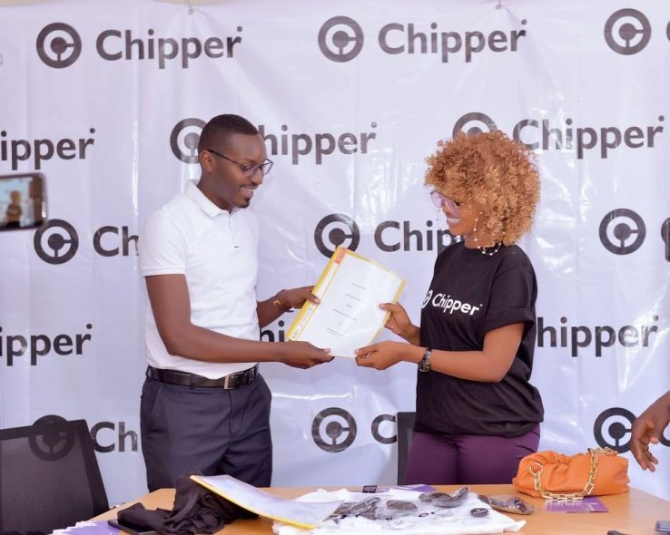 Singer Spice Diana (R) after signing (Chipper Cash (PHOTO/Courtesy).