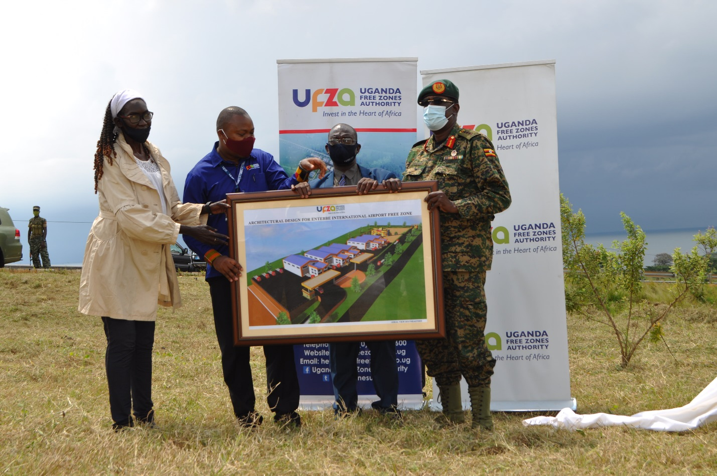 The Uganda Free Zones Authority (UFZA) team (L-R Ms Grace Achire Labong – Vice Chairperson, Board of Directors, Mr. Hez Kimoomi Alinda – Executive Director and Eng. Dr. Feredrick Kiwanuka - Chairman, Board of Directors) hand over the architectural designs for construction of Entebbe International Airport Free Zone to Gen. James Mugira – Managing Director, National Enterprise Corporation (NEC) (PHOTO/Courtesy)