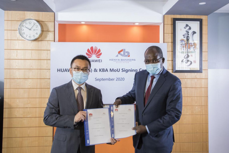 Kenya Bankers Association CEO Dr. Habil Olaka (right) with Huawei-Kenya Chief Executive Officer Mr. Will Meng during the signing a memorandum of understanding. Under the agreement, the two organizations will organize financial ICT-related activities (PHOTO/Courtesy).
