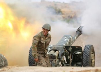 An ethnic Armenian soldier fires an artillery piece during fighting with Azerbaijans forces in the breakaway region of Nagorno-Karabakh (PHOTO/Courtesy).