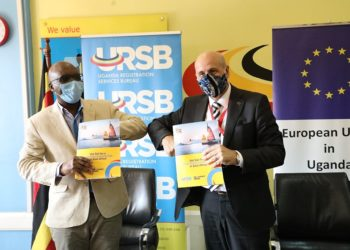 EU Ambassador to Uganda, His Excellency, Attilio Pacifici shares partnership documents with Bemanya Twebaze, Registrar General of the Uganda Registration Services Bureau (PHOTO/Courtesy).