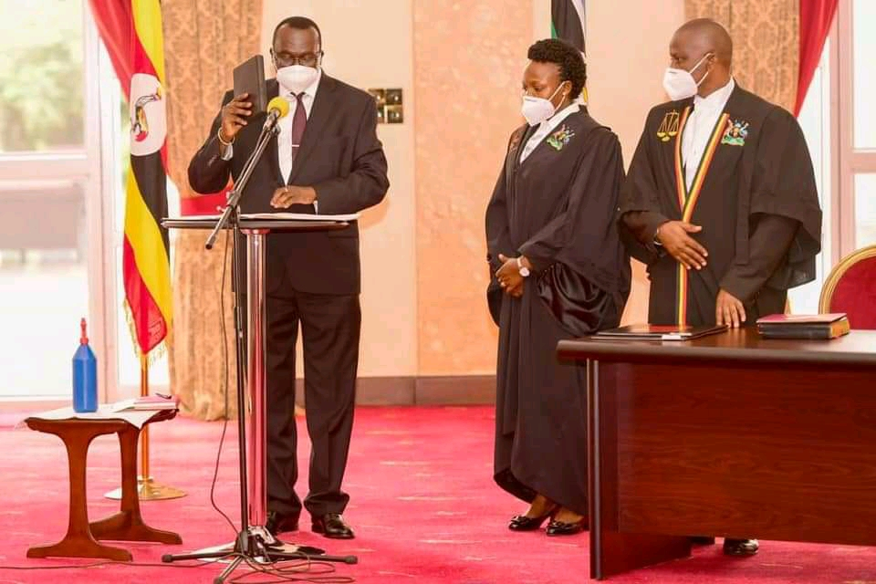 Chief Justice, Alphonse Owiny-Dollo taking an oath at State House on Tuesday (PHOTO/Courtesy).