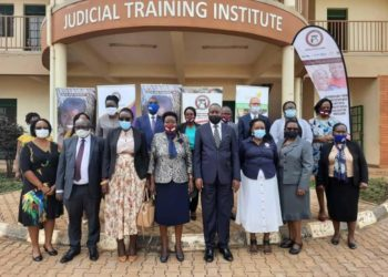 Officials from Judiciary and Rehab Uganda in a group photo at Judicial Training Institute (PHOTO/Courtesy).