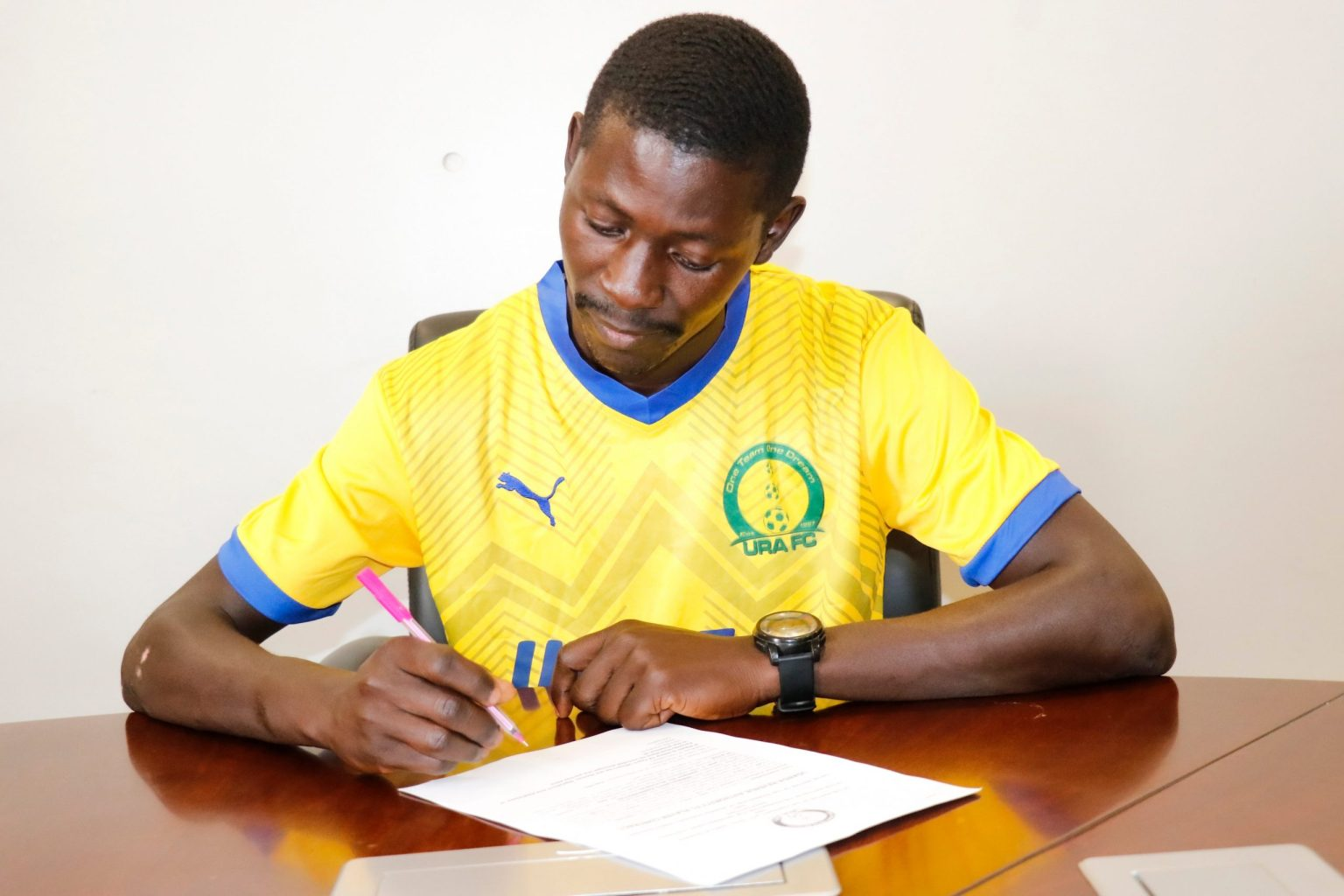 Sebwalunyo signing his deal with URA FC on Tuesday. (PHOTO/Courtesy)