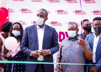 Dr. Dan Byamukama, Commissioner at Uganda AIDS commission cuts the ribbon (PHOTO/Courtesy)