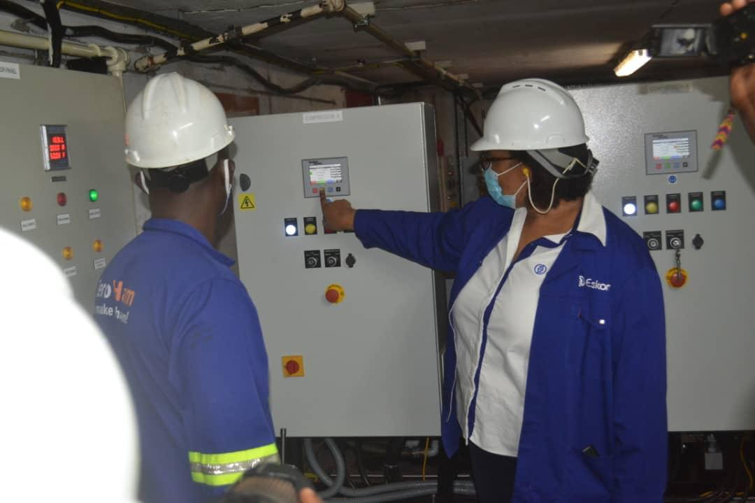 Thozama Gangi, Eskom Uganda Managing Director (R) commissions the compressed air system at Nalubaale Power Station. With back to camera is Filbert Kinyanda, Technical Director at API Technical Consultants, the project contractor (PHOTO/PML Daily).