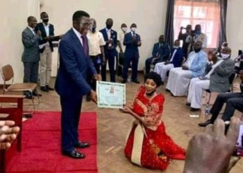 Katikiro of Buganda Charles Peter Mayiga presenting an award of appreciation to Bad Black (PHOTO/Courtesy).