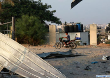 A Palestinian man rides a motorcycle passing by a site stricken by Israeli aircrafts in the northern Gaza Strip town of Beit Lahia, on Sept. 16, 2020 (PHOTO/Courtesy).