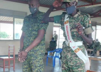 The sentenced RA/241764 Pte Rubagumya Cephas (L) appearing before the court (PHOTO/Courtesy).