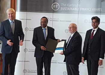 Ambassador of Uganda to Germany Marcel R. Tibaleka (2nd left) receiving the award on behalf of UDB on Wednesday (PHOTO/Courtesy).