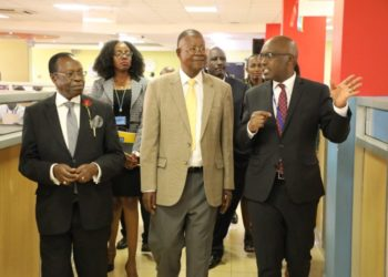 Minister of Justice & Constitutional Affairs, Prof. Ephraim Kamuntu (centre) flanked by Bemanya Twebaze, the Registrar General, Bemanya Twebaze and URSB Board Chair, Ambassador Francis K. Butagira during the minister's tour of the URSB One Stop Centre (PHOTO/Courtesy).