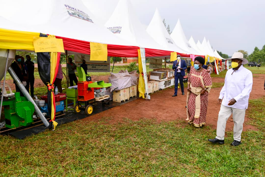President Museveni being welcomed by speaker of Parlliament Ms Kadaga at thge functionto hand over state-of-the- art Business start-up tool kits to 3 ,228 youth and women (PHOTO/Courtesy).