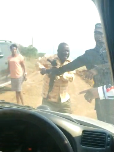 Minister Rukutana was pictured seizing a rifle in the shooting incident in which one person was seriously injured (PHOTO/Courtesy).