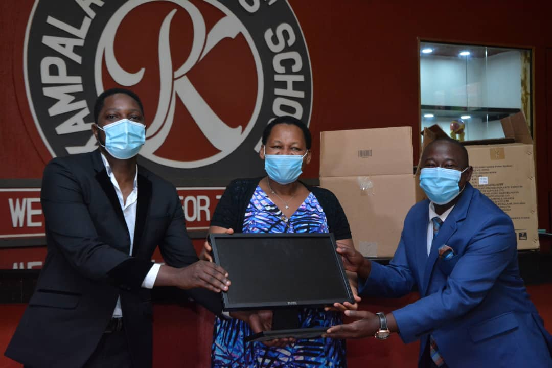 Officials from Ruparelia Foundation handing over computers to Mr. Solomon Sserwanja the Institute's Executive Director (right) (PHOTO/Courtesy).