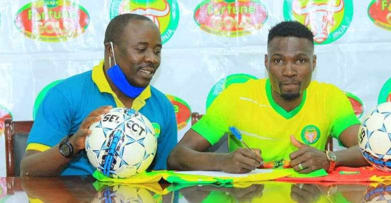 Ambrose Kirya (Right) signing for BUL FC. (PHOTO/Courtesy)