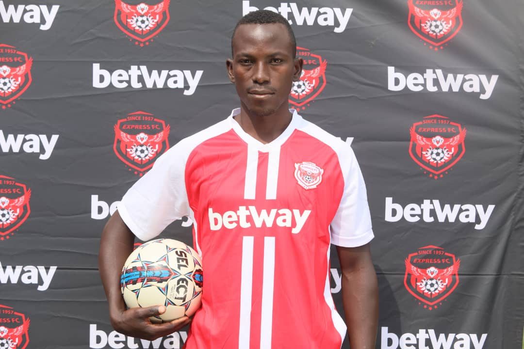Denis Mugerwa poses with a ball during his unveiling on Tuesday, September 22. (PHOTO/Courtesy)