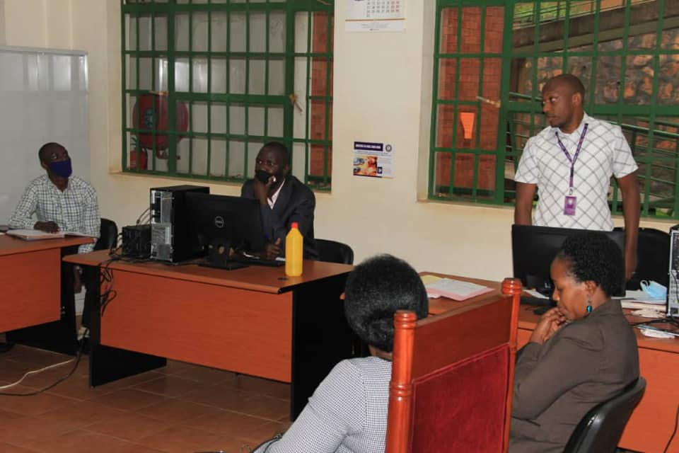 Justice Susan Abinyo of the Commercial Court with the Systems Administrator, clerks, and the in-charge of the Open Registry at the Division during a meeting (PHOTO/Courtesy).